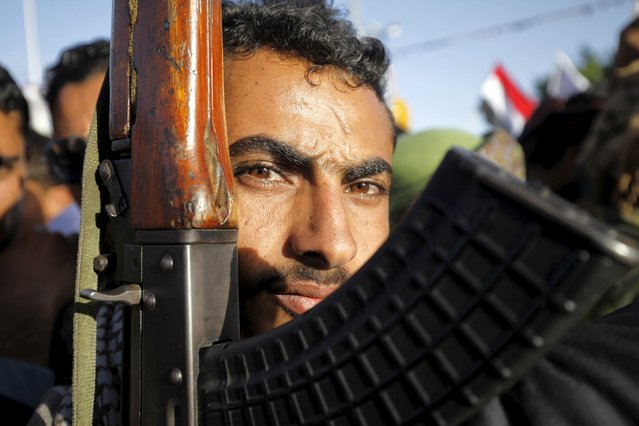 A follower of the Houthi movement raises his rifle during a rally against the Saudi-led coalition in Yemen's capital Sanaa October 2, 2015. (Photo by Mohamed al-Sayaghi/Reuters)