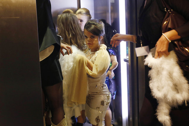 Models get in an elevator moments before hitting the catwalk at the French Ministry of Culture during the dwarf fashion show  in Paris, France, Friday October 2, 2015. (Photo by Jerome Delay/AP Photo)