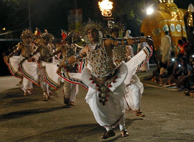 Sri Lankan traditional dancers perform during the annual Perahera (street pageant) at Rajamaha viharaya Buddhist temple in Colombo, Sri Lanka September 10, 2016. (Photo by Dinuka Liyanawatte/Reuters)
