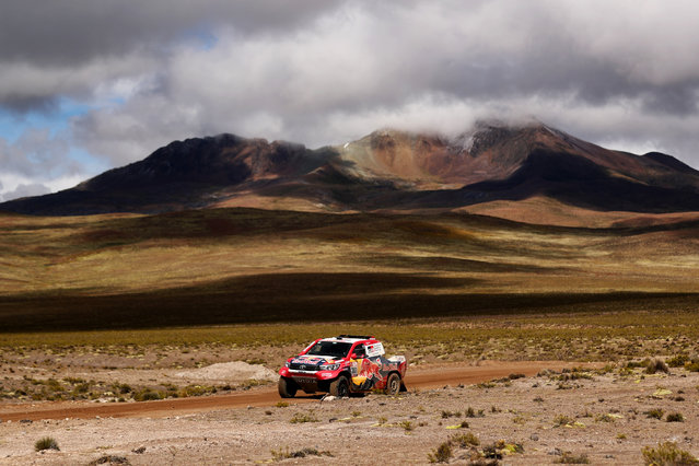 Nasser Al-Attiyah of Qatar and Toyota Gazoo Racing drives with co-driver Matthieu Baumel of France in the Hilux Toyota car in the Classe : T1.1 : 4x4 Essence during stage six of the 2018 Dakar Rally between Arequipa, Peru and La Paz, Bolivia on January 11, 2018 at an unspecified location. (Photo by Dan Istitene/Getty Images)