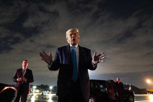 President Donald Trump talks with reporters at Andrews Air Force Base after attending a campaign rally in Latrobe, Pa., Thursday, September 3, 2020, at Andrews Air Force Base, Md. (Photo by Evan Vucci/AP Photo)