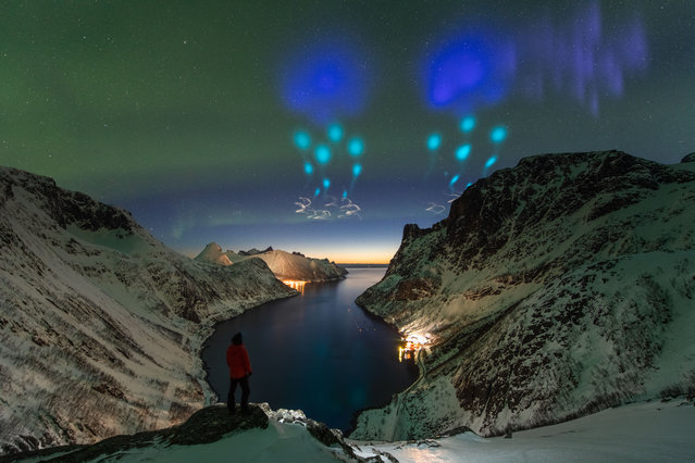 People and space. Highly commended: Azure Vapor Tracers by Yang Sutie (China). At the top of fjords in Arctic Norway, the photographer was met with an unknown sky. Was it aliens? Was it the supernatural? He captured a series of photos to record the night and didn't know until the next day that the colours were actually created by the auroral zone upwelling rocket experiment from Andøya Space Centre, which dispersed gas tracers to probe winds in Earth's upper atmosphere. (Photo by Yang Sutie/2020 Astronomy Photographer of the Year)