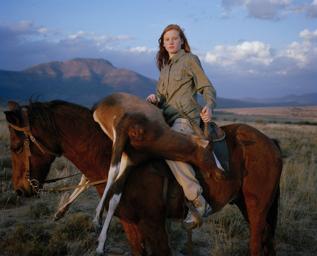"""Huntress with Buck from the series «Hunters»"". Taylor Wessing photographic portrait prize 2010. (Photo by David Chancellor)"