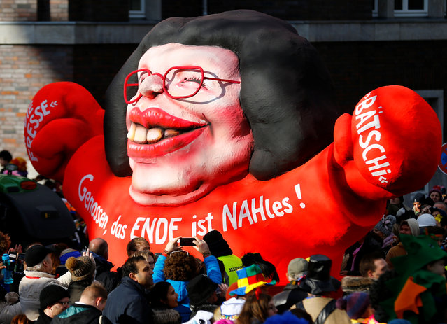 """A carnival float depicting Social Democratic Party SPD parliamentary group leader Andrea Nahles at the traditional """"Rosenmontag"""" Rose Monday carnival parade in Duesseldorf, Germany on February 12, 2018. Words read: """"Comrades, the end is Nahles"""". (Photo by Thilo Schmuelgen/Reuters)"""