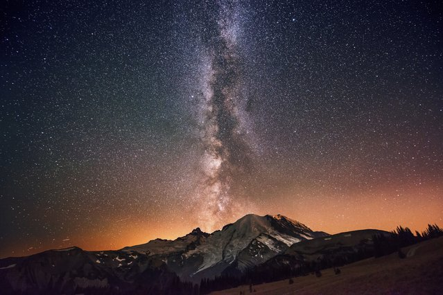 """The Milky Way Galaxy Exploding from Mount Rainier"". Photo by David Morrow (Everett, Washington). Photographed at Sunrise Point in Mount Rainier National Park, Washington, October 6, 2012."