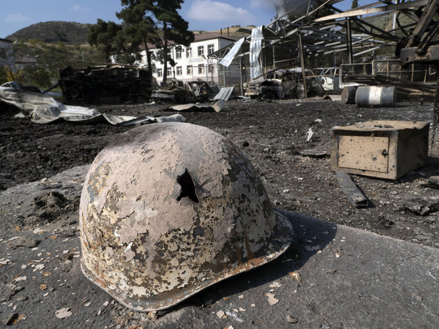 A broken solder's helmet is seen in a local hospital damaged by shelling from Azerbaijan's artillery during a military conflict, in the town of Martakert, the separatist region of Nagorno-Karabakh, Thursday, October 15, 2020. The conflict between Armenia and Azerbaijan is escalating, with both sides exchanging accusations and claims of attacks over the separatist territory of Nagorno-Karabakh. (Photo by AP Photo/Stringer)