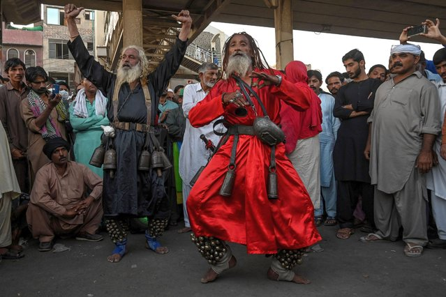 """Devotees perform at the Data Darbar Shrine on the second day of a three-day annual Sufi religious festival called """"Urs"""" in Lahore on October 7, 2020. The Data Darbar complex contains the shrine of Saint Syed Ali bin Osman Al-Hajvery, popularly known as Data Ganj Bakhsh. (Photo by Arif Ali/AFP Photo)"""