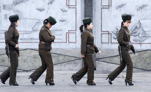 Female North Korean soldiers patrol along the banks of Yalu River, near the North Korean town of Sinuiju, opposite the Chinese border city of Dandong, April 11, 2013. South Korea and the United States were on high alert for a North Korean missile launch on Thursday as the hermit kingdom turned its attention to celebrating its ruling Kim dynasty and appeared to tone down rhetoric of impending war. (Photo by Jacky Chen/Reuters)