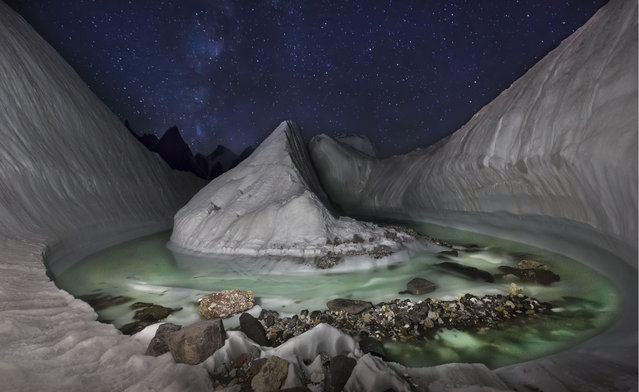 Polish photographer David Kaszlikowski took a series of stunning photographs of a glacier in the Karakoram region of Pakistan while on a film expedition. At the Baltoro and Godwin-Austen glaciers near K2, the second highest mountain in the world, he sent his drone on flights to scout the surrounding landscape. Here: at the heart of Karakoram, a glacier formation found at Concordia at the very beginning of one of the longest glaciers on the planet, Baltoro. (Photo by David Kaszlikowski/Rex Features)