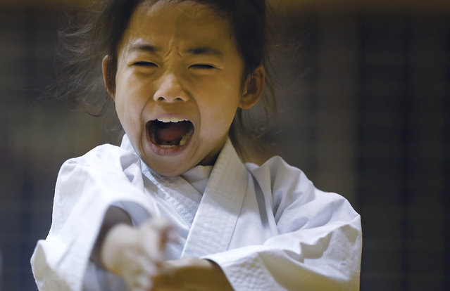 """In this November 18, 2015 photo, 9-year-old Mahiro Takano, three-time Japan karate champion in her age group practices in Nagaoka, Niigata prefecture, north of Tokyo. Mahiro stars in singer Sia's latest music video """"Alive"""", the just-released single from the singer's upcoming album. (Photo by Eugene Hoshiko/AP Photo)"""