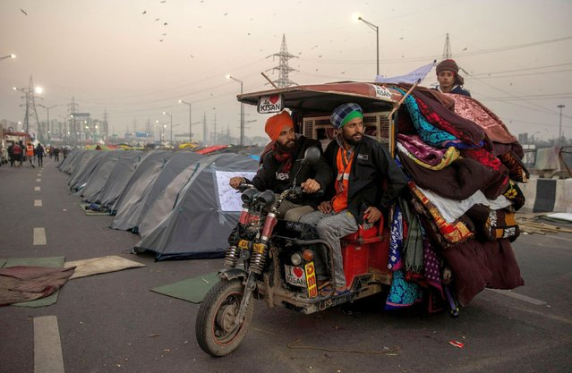 Farmers transport blankets and mattresses at the site of a protest against new farm laws, at the Delhi-Uttar Pradesh border in Ghaziabad, India, January 11, 2021. (Photo by Danish Siddiqui/Reuters)