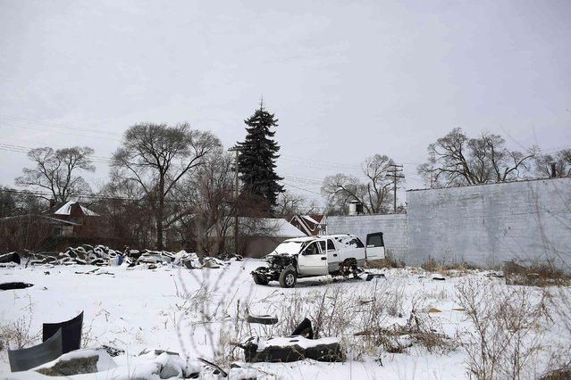 A Chevrolet Suburban 1500 that was stripped of its parts sits in a vacant lot behind a building in Detroit, Michigan January 10, 2015. (Photo by Joshua Lott/Reuters)