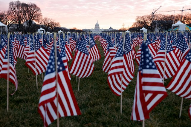 Thousands of U.S. flags are seen at the National Mall, to represent the people who are unable to travel to Washington for the inauguration, in Washington, U.S., January 18, 2021. (Photo by Carlos Barria/Reuters)
