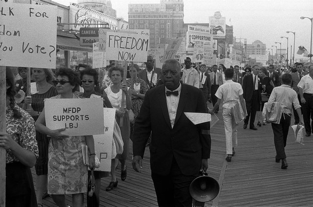 "Marchers, including white Mississippi Freedom Democratic Party supporters, holding signs reading ""Freedom now"" and ""MFDP supports LBJ"" while marching on the boardwalk outside the 1964 Democratic National Convention in Atlantic City, New Jersey, August 1964. (Photo by Reuters/Library of Congress)"
