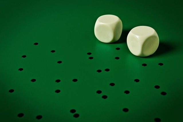 Dice with no dots. (Photo by Giuseppe Colarusso/Caters News)