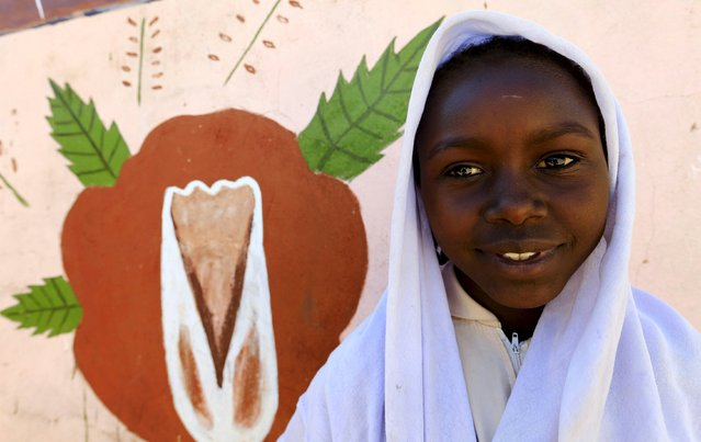 Tahani Abdallah Omer, a 5th grader at Alsalam 2 School for Girls at Aboshok camp for the Internally displaced poses for a photograph in El-Fasher in North Darfur, Sudan, November 17, 2015. Born in the camp, 12 years old Omer wishes to be a doctor or  a teacher like her aunt in her adulthood. (Photo by Mohamed Nureldin Abdallah/Reuters)
