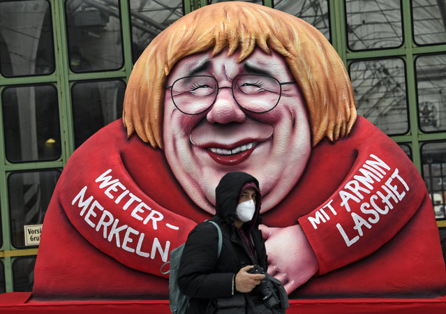 A political carnival float depicting German chancellor Angela Merkel and her possible successor Governor Armin Laschet is rolled out to be shown in the streets of Duesseldorf, Germany, Monday, February 15, 2021. (Photo by Martin Meissner/AP Photo)