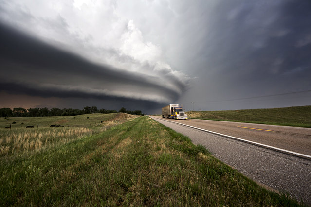 A semi truck and the bothership in Bartlett, Nebraska from 2013. (Photo by Camille Seaman/Caters News)