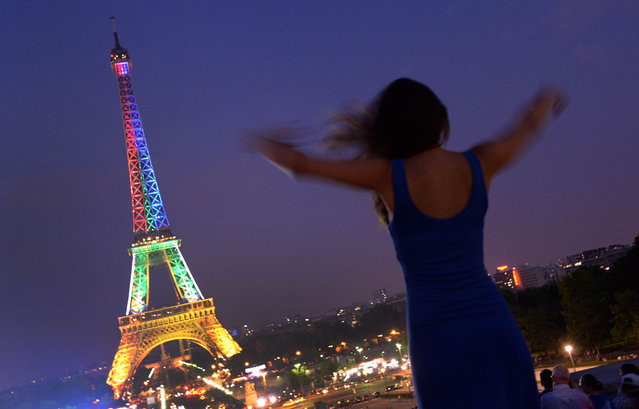 The Eiffel Tower in Paris is floodlit in the colours of the South African flag on July 18, 2013 in honour of Mandela Day, the birthday of Nelson Mandela. (Photo by Pierre Andrieu/AFP Photo)