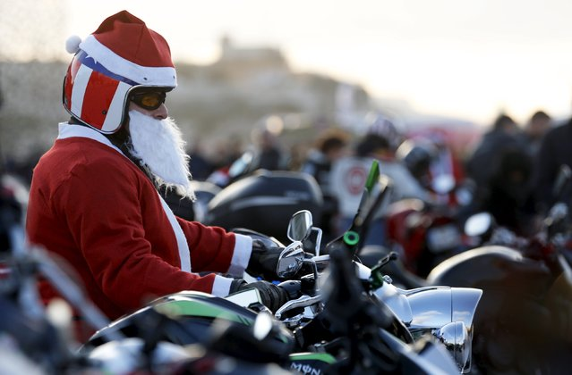 A biker dressed as Santa Claus takes part in a charity ride to bring gifts to hospitalized children in Marseille, France, December 20, 2015. (Photo by Jean-Paul Pelissier/Reuters)
