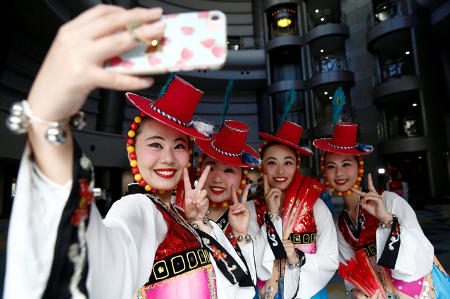 High school students from a dance club at Kanagawa Korean Middle and High School take a selfie after their traditional dance performance at a local international day event to promote a multicultural society in Yokohama, Kanagawa Prefecture, Japan, May 20, 2018. (Photo by Kim Kyung-Hoon/Reuters)