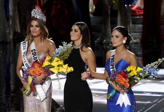 Miss Colombia Ariadna Gutierrez (L), Miss Universe 2014 Paulina Vega (C) and Miss Philippines Pia Alonzo Wurtzbach stand together onstage during the 2015 Miss Universe Pageant in Las Vegas, Nevada, December 20, 2015. Miss Colombia was originally announced as the winner but host Steve Harvey said he made a mistake when reading the card. Miss Philippines Pia Alonzo Wurtzbach is the actual winner. (Photo by Steve Marcus/Reuters)