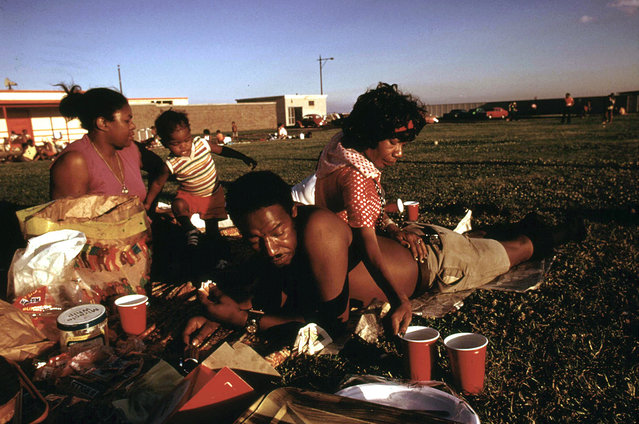 A family enjoys a picnic at 12th Street Beach on Lake Michigan, August 1973. (Photo by John H. White/NARA via The Atlantic)
