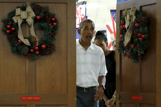 U.S. President Barack Obama, with first lady Michelle Obama, arrives to deliver remarks at a Christmas reception with service members at Marine Corps Base Hawaii in Kaneohe Bay, Hawaii December 25, 2015. (Photo by Jonathan Ernst/Reuters)