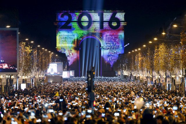 Revellers gather near the Arc de Triomphe on the Champs Elysees Avenue in Paris, France, during New Year celebrations, early January 1, 2016. (Photo by Charles Platiau/Reuters)