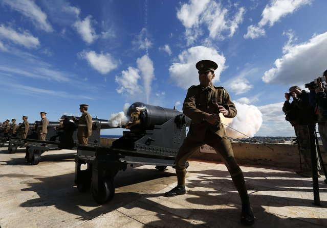 Malta Heritage Trust historical re-enactors, in World War One-era Royal Malta Artillery uniforms, fire the cannons in a general salute to mark the feast of Saint Paul's Shipwreck at the Upper Barrakka Saluting Battery in Valletta February 10, 2015. The Maltese trace their conversion to Christianity to Saint Paul's three-month stay on the island in 60AD, after he was shipwrecked on the island. (Photo by Darrin Zammit Lupi/Reuters)