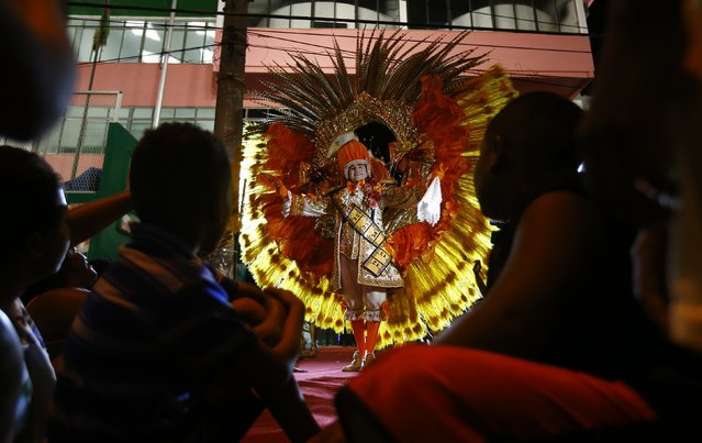 A participant attends a carnival luxurious costume contest at the entrance of the Glam Gay pre-carnival Ball, in Mangueira samba school in Rio de Janeiro February 11, 2015. (Photo by Ricardo Moraes/Reuters)