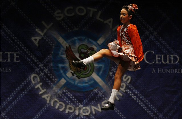 Dancer Niamh O'Connor performs in one of the heats during the All Scotland Championships in Irish Dancing at the Royal Concert Hall in Glasgow, Scotland February 22, 2013. The championship takes place until Monday with over 2000 dancers taking part from over 300 dance schools from as far afield as North America, South Africa, Australia and Russia. (Photo by David Moir/Reuters)