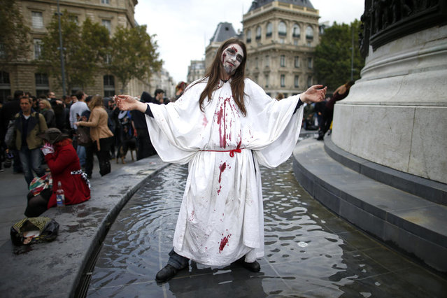 A man dressed as a zombie participates in a Zombie Walk procession in the streets of Paris October 12, 2013. (Photo by Benoit Tessier/Reuters)
