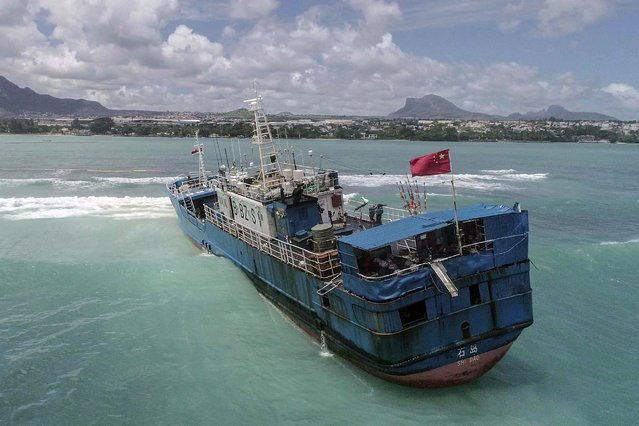 An aerial view taken on March 8, 2021, shows Chinese fishing vessel Lurong Yuan Yu that ran aground on reefs of Pointe-aux-Sables in Port Louis, Mauritius, on March 7, 2021. (Photo by L'Express Maurice/AFP Photo)