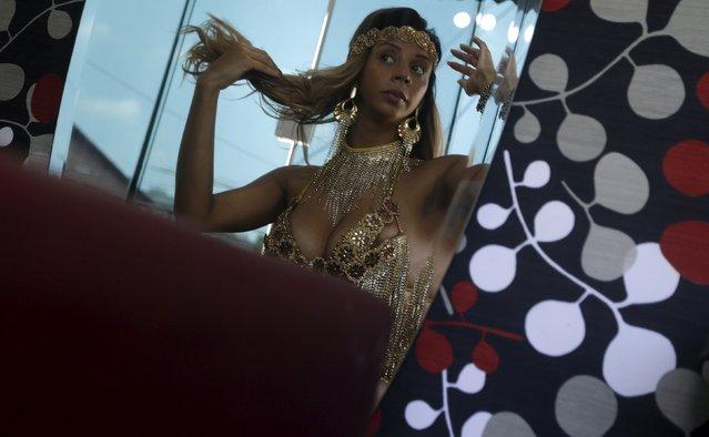 Larissa Neto, a muse of the Unidos da Tijuca Samba School, wears a carnival dress in Sao Goncalo near Rio de Janeiro, Brazil, February 3, 2016. (Photo by Ricardo Moraes/Reuters)
