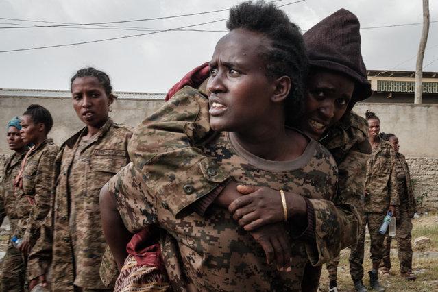 Captive Ethiopian female soldiers arrive at the Mekele Rehabilitation Center in Mekele, the capital of Tigray region, Ethiopia, on July 2, 2021. (Photo by Yasuyoshi Chiba/AFP Photo)