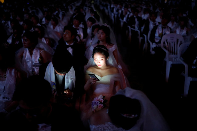 Couples attend a mass wedding ceremony of the Unification Church at Cheongshim Peace World Centre in Gapyeong, South Korea, August 27, 2018. (Photo by Kim Hong-Ji/Reuters)