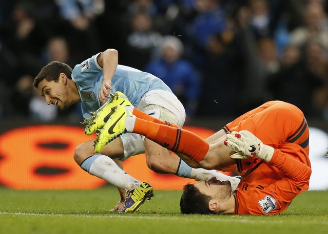 Manchester City's Jesus Navas (L) celebrates after scoring his second goal past Tottenham Hotspur goalkeeper Hugo Lloris (R) during their English Premier League soccer match at the Etihad Stadium in Manchester, northern England November 24, 2013. (Photo by Phil Noble/Reuters)