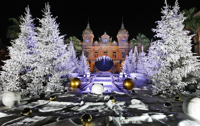 Christmas trees are decorated in front of the Monte Carlo Casino in Monaco. (Photo by Lionel Cironneau/Associated Press)