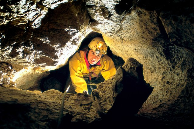 A caver inside the Cehi II cave, Slovenia. (Photo by Peter Gedei/Caters News)