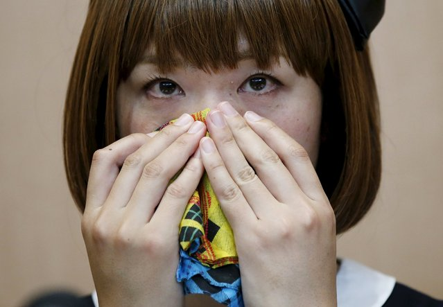 Japanese artist Megumi Igarashi, known as Rokudenashiko, wipes her nose during a news conference following a court appearance in Tokyo April 15, 2015. (Photo by Toru Hanai/Reuters)