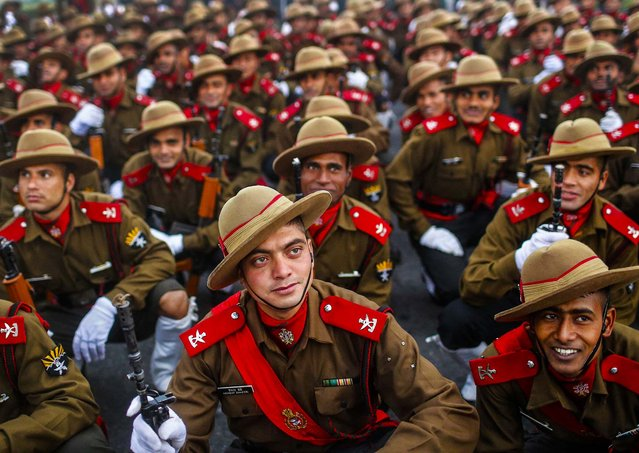 Soldiers rest after their rehearsal for the Republic Day parade on a cold winter morning in New Delhi, on January 2, 2013. India will celebrate its annual Republic Day on January 26. (Photo by Anindito Mukherjee/Reuters)