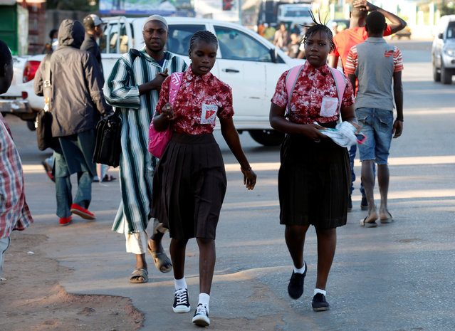 Two school girls walk at Kairaba avenue in Banjul, Gambia January 24, 2017. (Photo by Thierry Gouegnon/Reuters)