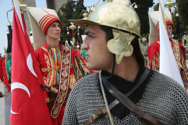 Performers in historical costumes rehearse a ceremony at the Canakkale Martyrs' Memorial, which is the biggest memorial to Turkish soldiers killed during the Gallipoli Campaign, ahead of commemorations on April 22, 2015 near Sedd el Bahr, Turkey. (Photo by Sean Gallup/Getty Images)