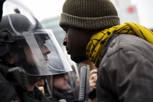 A demonstrator confronts a policeman near Camden Yards as they protest the death in police custody of Freddie Gray in Baltimore April 25, 2015. (Photo by Sait Serkan Gurbuz/Reuters)