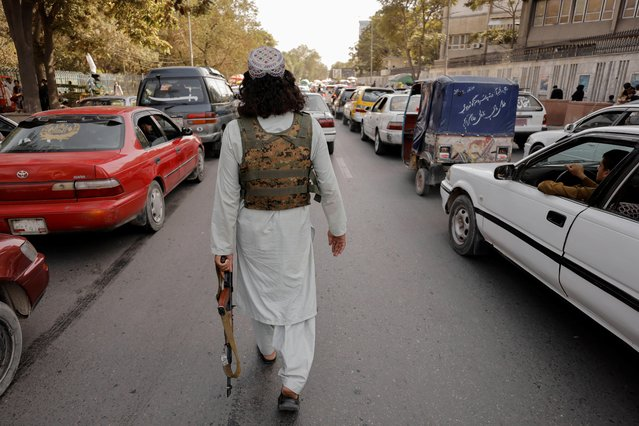 A member of Taliban forces patrols a street in Kabul, Afghanistan, October 3, 2021. (Photo by Jorge Silva/Reuters)