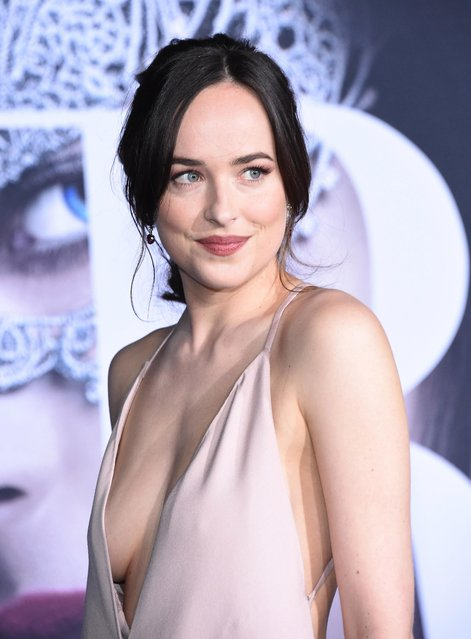 """Actress Dakota Johnson arrives at the premiere of Universal Pictures' """"Fifty Shades Darker"""" at The Theatre at Ace Hotel on February 2, 2017 in Los Angeles, California. (Photo by SilverHub Media)"""