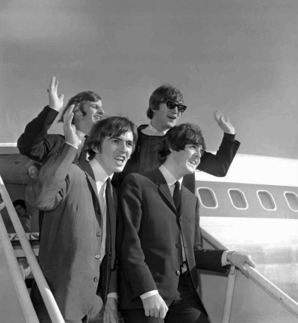 The Beatles wave after arriving at the San Francisco airport August 18, 1964 to begin an American tour. Clockwise from top right; John Lennon, Paul McCartney, George Harrison and Ringo Starr. (Photo by AP Photo)