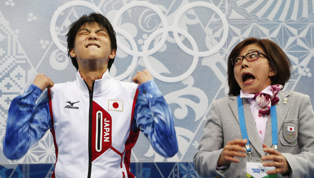 "Japan's Yuzuru Hanyu and figure skating coach Yoshiko Kobayashi react in the ""kiss and cry"" area during the figure skating men's short program at the Sochi 2014 Winter Olympics February 13, 2014. (Photo by Lucy Nicholson/Reuters)"