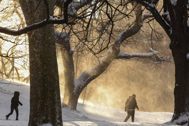 People walk through Fort Greene Park during winter storm Niko in the Brooklyn borough of New York City, U.S. February 9, 2017. (Photo by Stephanie Keith/Reuters)